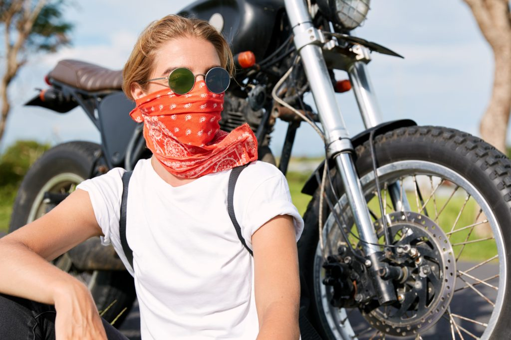 Female biker wearing a bandana