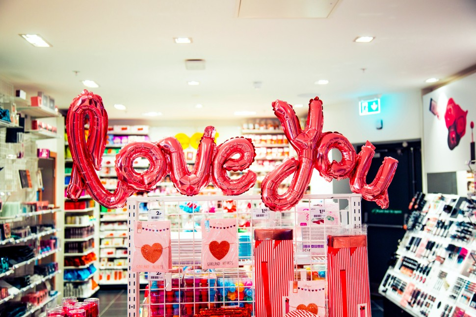 Love You balloons blown up in the middle of a drugstore.