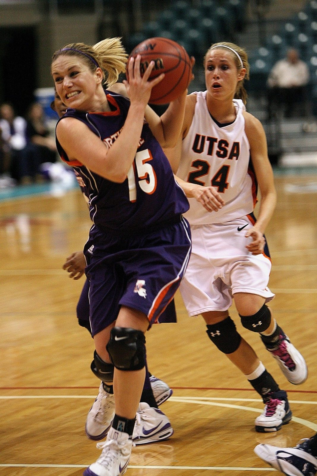 Student athletes playing on the court during a game.